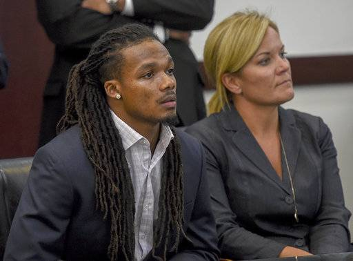FILE - In this June 23, 2017, file photo, Brandon Banks, left, and his attorney Katie Hagan react after the verdict was read in his trial in Nashville, Tenn. Banks, a former Vanderbilt University football player, has been sentenced to 15 years in prison Friday, Aug. 18, 2017, for the 2013 rape of an unconscious female student. (Lacy Atkins/The Tennessean via AP, File)