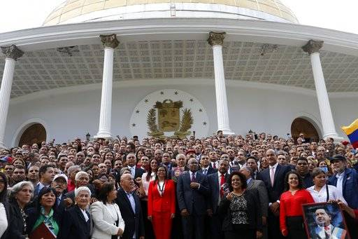 FILE - In this Aug. 4, 2017, file photo, Venezuela's Constituent Assembly poses for an official photo after being sworn in, at Venezuela's National Assembly in Caracas, Venezuela. Delegates to the all-powerful assembly unanimously approved a decree Friday, August 18, giving it the authority to pass legislation on a range of issues affecting Venezuela's security and sovereignty. (AP Photo/Ariana Cubillos, File)
