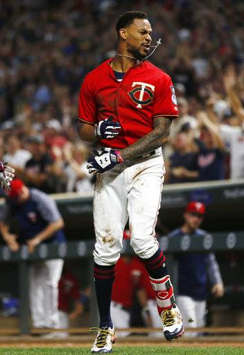 Minnesota Twins' Byron Buxton celebrates his inside-the-park home run off Arizona Diamondbacks pitcher Zack Godley during the fourth inning of a baseball game Friday, Aug. 18, 2017, in Minneapolis. (AP Photo/Jim Mone)