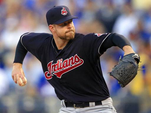 Cleveland Indians starting pitcher Corey Kluber delivers to a Kansas City Royals batter during the first inning of a baseball game at Kauffman Stadium in Kansas City, Mo., Friday, Aug. 18, 2017. (AP Photo/Orlin Wagner)