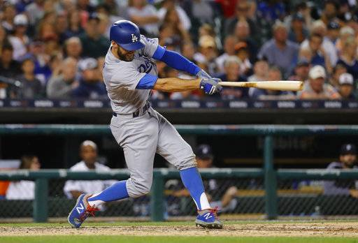 Los Angeles Dodgers' Chris Taylor doubles against the Detroit Tigers in the sixth inning of a baseball game in Detroit, Friday, Aug. 18, 2017. (AP Photo/Paul Sancya)