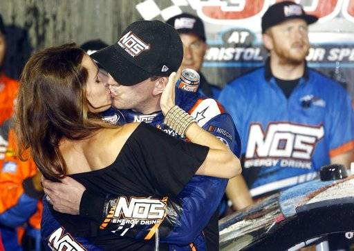 Kyle Busch gets a kiss from his wife, Samantha, after winning the NASCAR Xfinity Series auto race Friday, Aug. 18, 2017, in Bristol, Tenn. (AP Photo/Wade Payne)