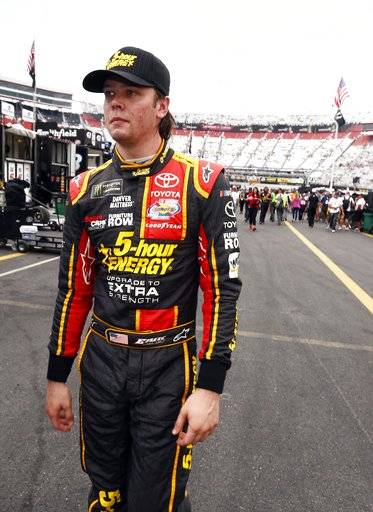Erik Jones makes his way through the pit area after qualifying for a NASCAR Cup Series auto race, Friday, Aug. 18, 2017, in Bristol, Tenn. Jones will start on the pole for Saturday's race. (AP Photo/Wade Payne)