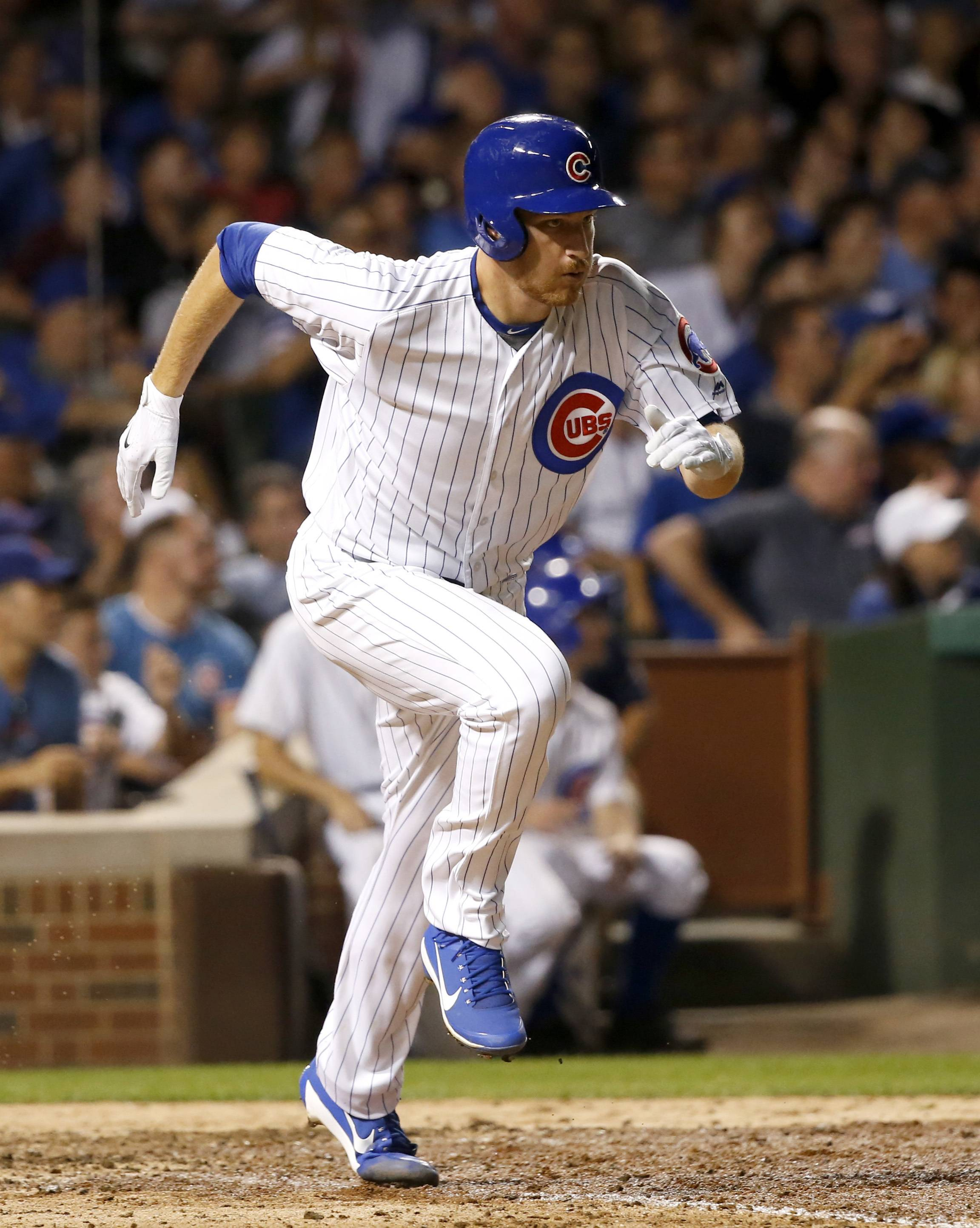 Chicago Cubs' Mike Montgomery heads to first after hitting a two-run double off Cincinnati Reds' Drew Storen during the seventh inning of a baseball game Monday, Aug. 14, 2017, in Chicago. Kyle Schwarber and Jason Heyward scored on the play.