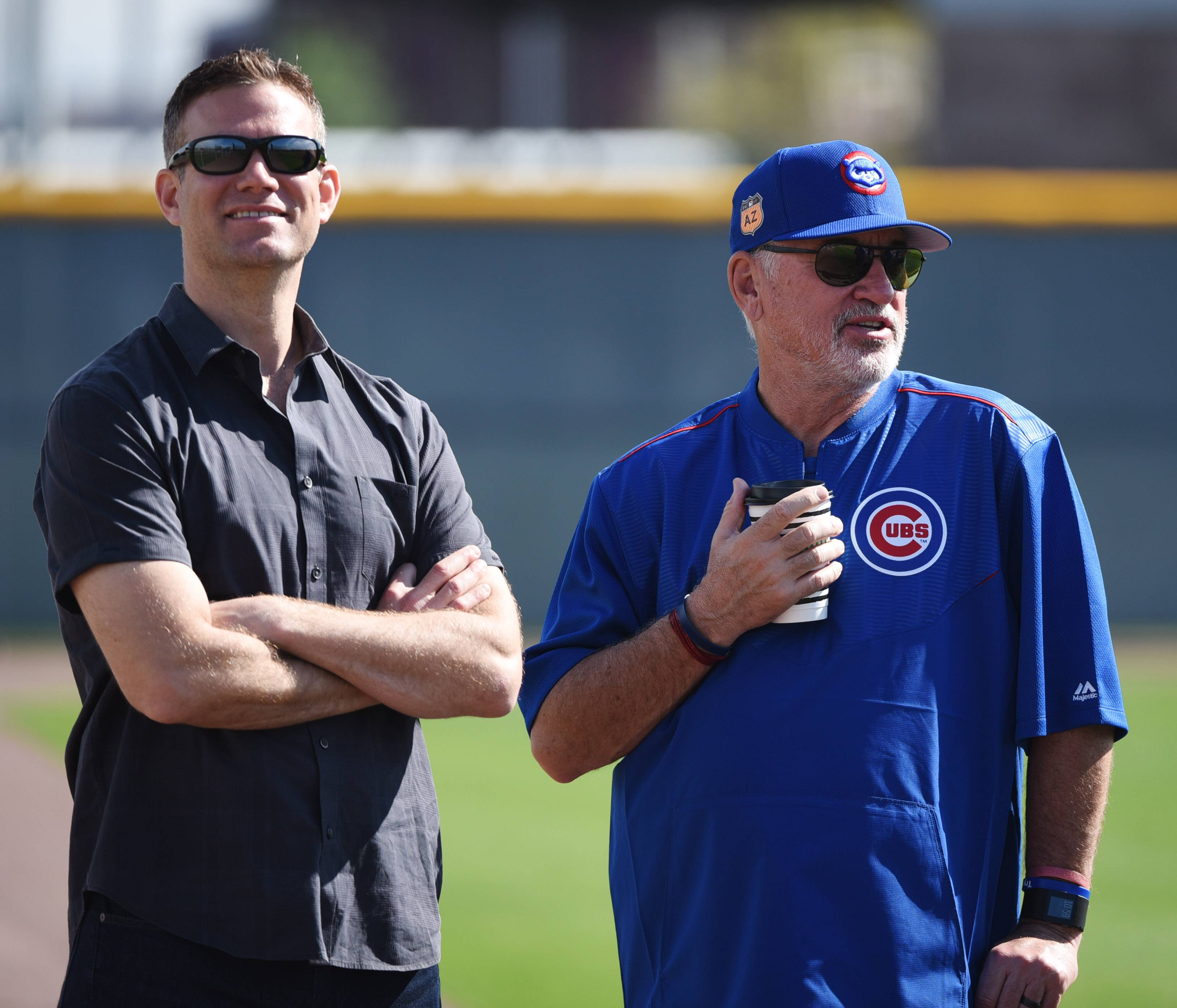 Theo Epstein, left, has followed through on the promises he made when he join the Chicago Cubs, yet some fans are unhappy with the way this season has gone.