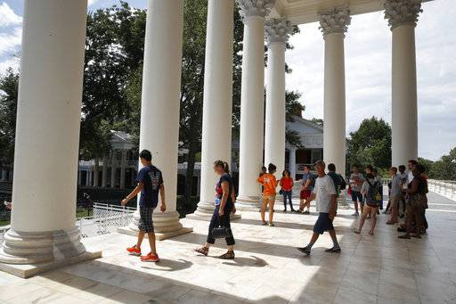 First year students tour the Rotunda of the University of Virginia, Friday, Aug. 18, 2017, in Charlottesville, Va., a week after a white nationalist rally took place on campus.