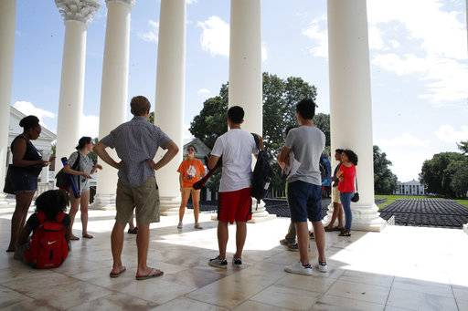 First year students tour the University of Virginia, Friday, Aug. 18, 2017, in Charlottesville, Va., a week after a white nationalist rally took place on campus.