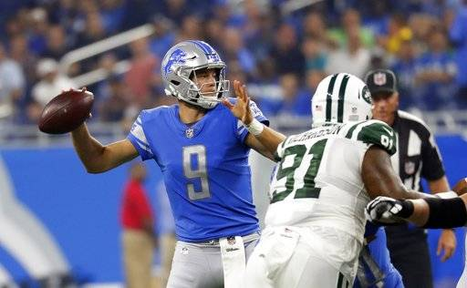 Detroit Lions quarterback Matthew Stafford throws during the first half of an NFL preseason football game against the New York Jets, Saturday, Aug. 19, 2017, in Detroit.