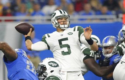 New York Jets quarterback Christian Hackenberg throws during the first half of an NFL preseason football game against the Detroit Lions, Saturday, Aug. 19, 2017, in Detroit.