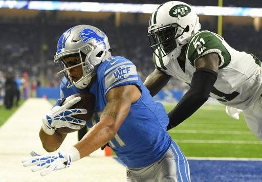 Detroit Lions wide receiver Marvin Jones (11), defended by New York Jets defensive back Morris Claiborne (21), falls out of bounds after catching a 5-yard pass for a touchdown during the first half of an NFL preseason football game, Saturday, Aug. 19, 2017, in Detroit.