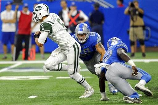 New York Jets quarterback Christian Hackenberg (5) pulls away from Detroit Lions defensive tackle Anthony Zettel (69) during the first half of an NFL preseason football game, Saturday, Aug. 19, 2017, in Detroit.
