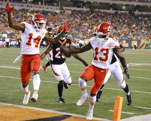 Kansas City Chiefs wide receiver De'Anthony Thomas (13) scores a touchdown during the second half of an NFL preseason football game against the Cincinnati Bengals, Saturday, Aug. 19, 2017, in Cincinnati.