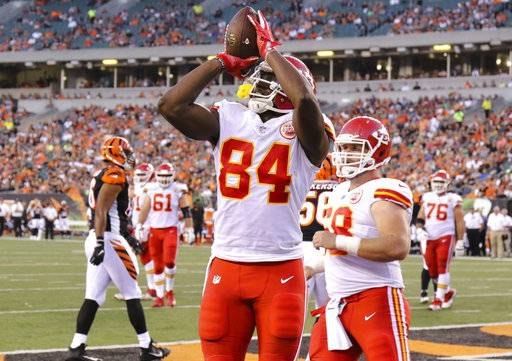 Kansas City Chiefs tight end Demetrius Harris (84) celebrates after scoring his second touchdown in the first half of an NFL preseason football game against the Cincinnati Bengals, Saturday, Aug. 19, 2017, in Cincinnati.