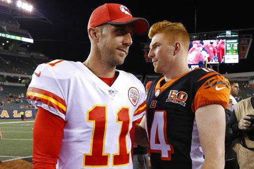 Kansas City Chiefs quarterback Alex Smith (11) and Cincinnati Bengals quarterback Andy Dalton (14) meet on the field after an NFL preseason football game, Saturday, Aug. 19, 2017, in Cincinnati. The Chiefs won 30-12.