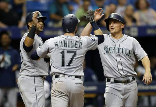 Seattle Mariners' Mitch Haniger, center, celebrates with Kyle Seager, right, and Nelson Cruz left, after Haniger hit a grand slam off Tampa Bay Rays starting pitcher Jake Odorizzi during the third inning of a baseball game Saturday, Aug. 19, 2017, in St. Petersburg, Fla.