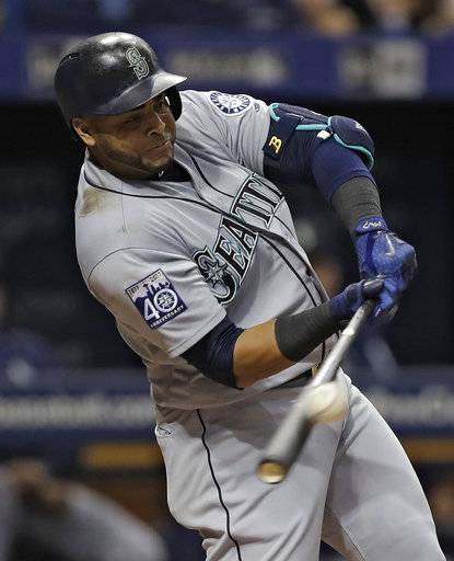 Seattle Mariners' Nelson Cruz connects for a two-run home run off Tampa Bay Rays starting pitcher Jake Odorizzi during the fourth inning of a baseball game Saturday, Aug. 19, 2017, in St. Petersburg, Fla. Mariners' Yonder Alonso also scored.