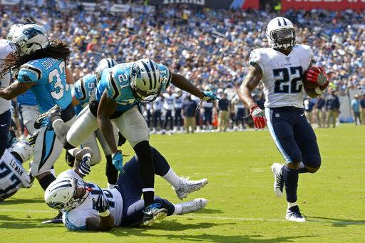 Tennessee Titans running back Derrick Henry (22) scores his second touchdown of the game on a 1-yard run ahead of Carolina Panthers defensive back Teddy Williams (21) in the first half of an NFL football preseason game, Saturday, Aug. 19, 2017, in Nashville, Tenn.
