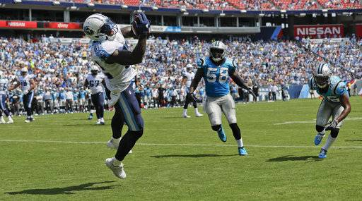 Tennessee Titans tight end Delanie Walker (82) catches a two-yard touchdown pass ahead of Carolina Panthers outside linebacker Thomas Davis (58) and cornerback Daryl Worley (26) in the first half of an NFL football preseason game Saturday, Aug. 19, 2017, in Nashville, Tenn.