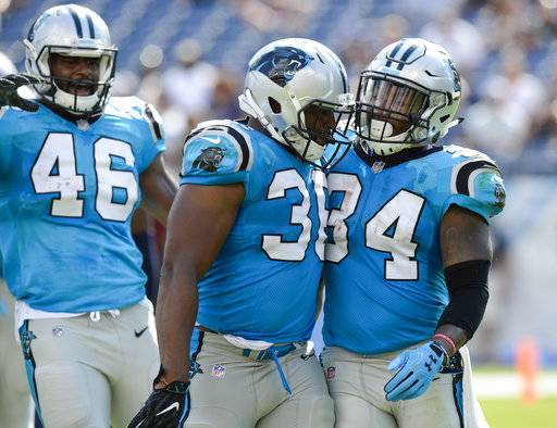 Carolina Panthers running back Cameron Artis-Payne (34) celebrates Darrel Young (36) and Eric Wallace (46) after Artis-Payne scored a touchdown on a 1-yard run against the Tennessee Titans in the second half of an NFL football preseason game Saturday, Aug. 19, 2017, in Nashville, Tenn.