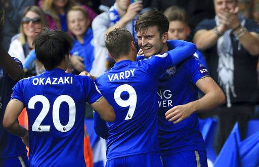 Leicester City's Harry Maguire, right, celebrates scoring his side's second goal during their English Premier League soccer match against Brighton at the King Power Stadium, Leicester, England, Saturday, Aug. 19, 2017. (Nigel French/PA via AP)