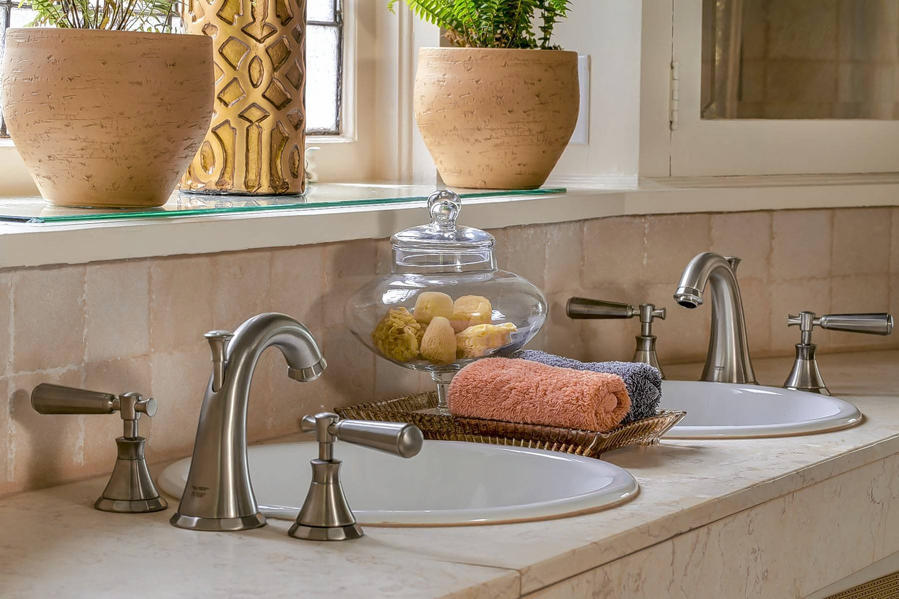 For the bathroom that is challenged by size, consider two facing sinks to save space.
