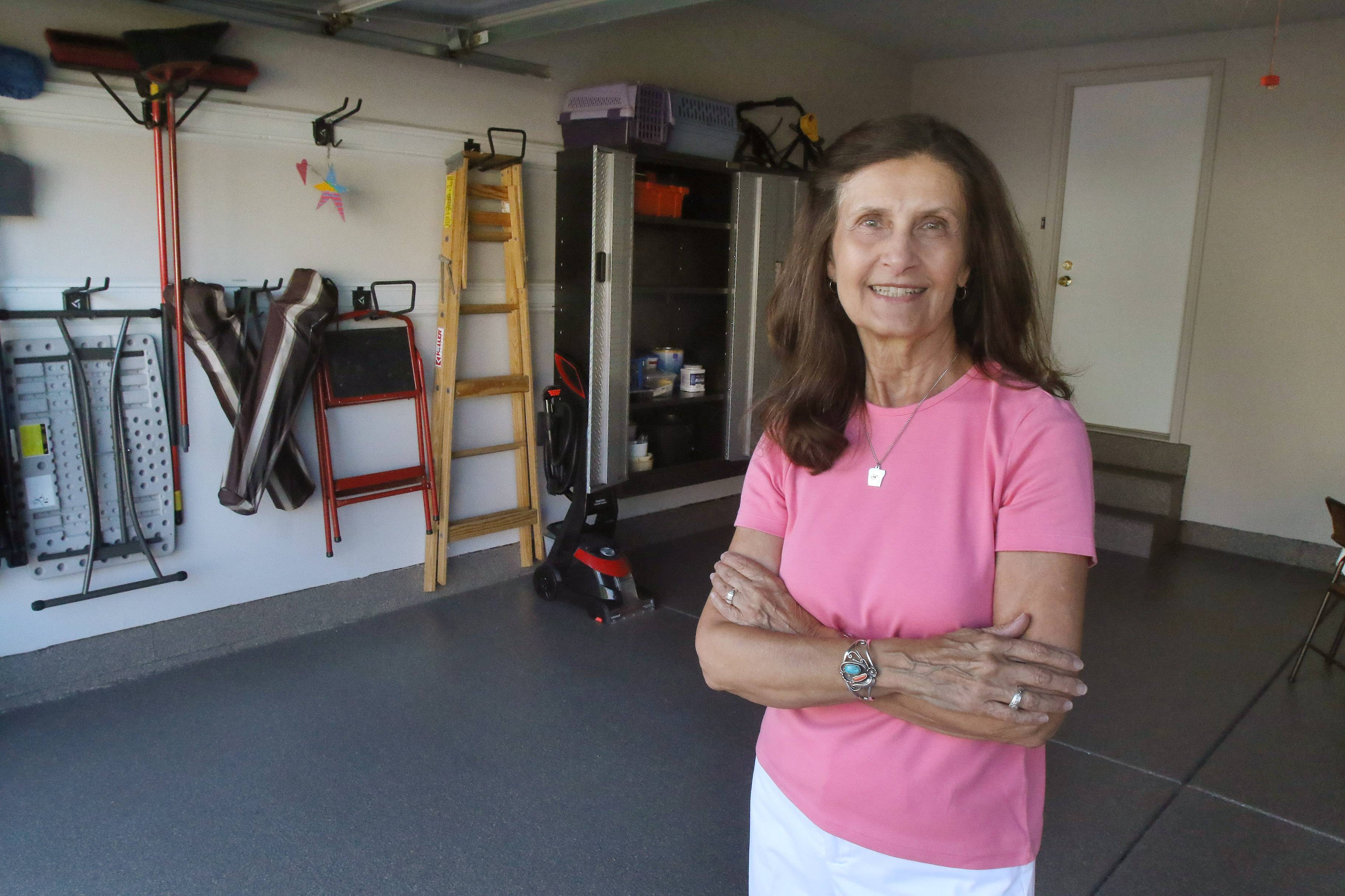 Palatine resident Denise Peterson shows off her garage improvements by the Garage Store. Peterson won a garage makeover through a contest sponsored by the business and the Daily Herald.