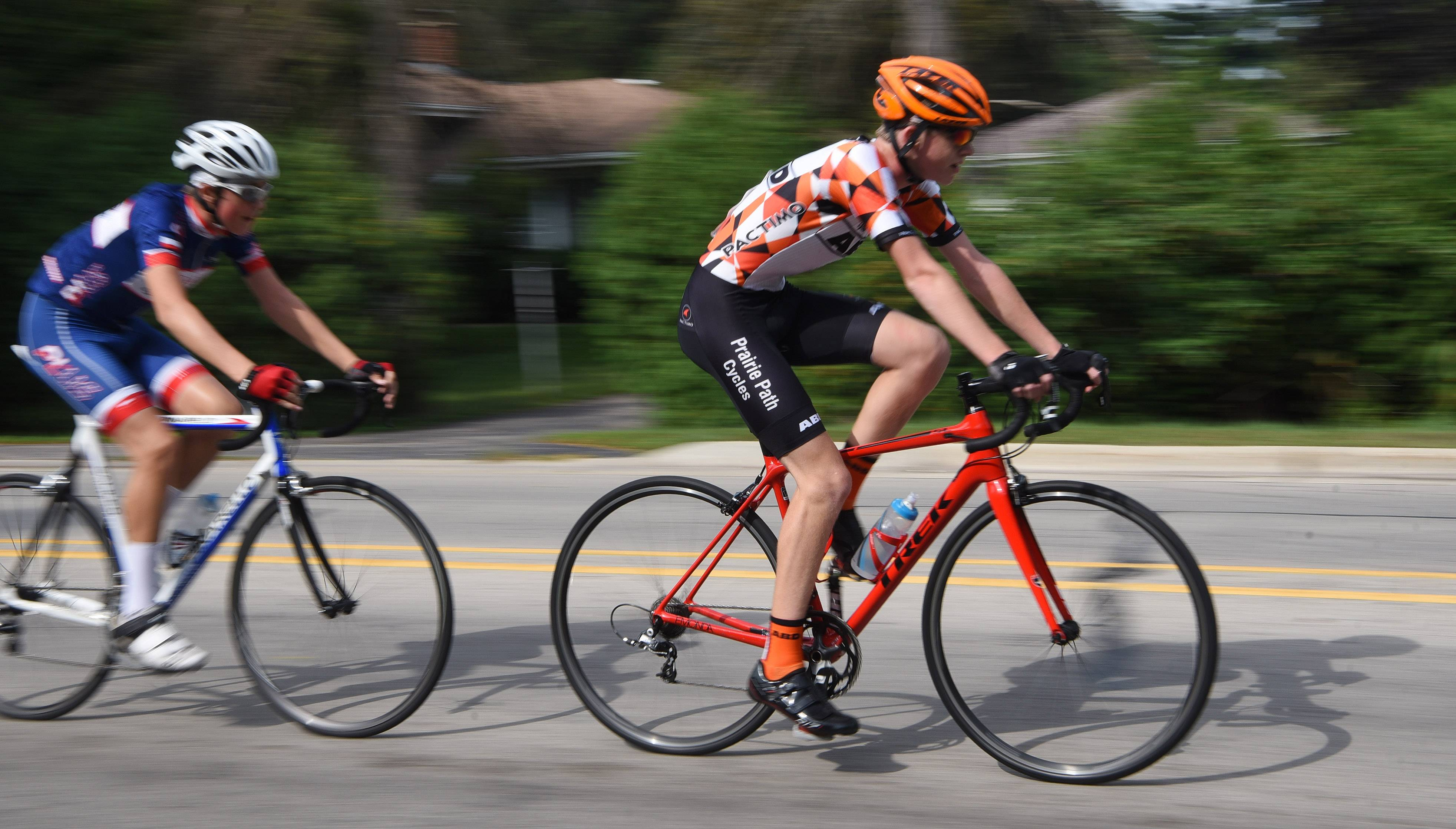 Will Holzhauer, right, of Geneva stays just ahead of David Kosela of Downers Grove in the USAC-Junior Boys 9-14 category at the Winfield Criterium bicycle races Sunday.