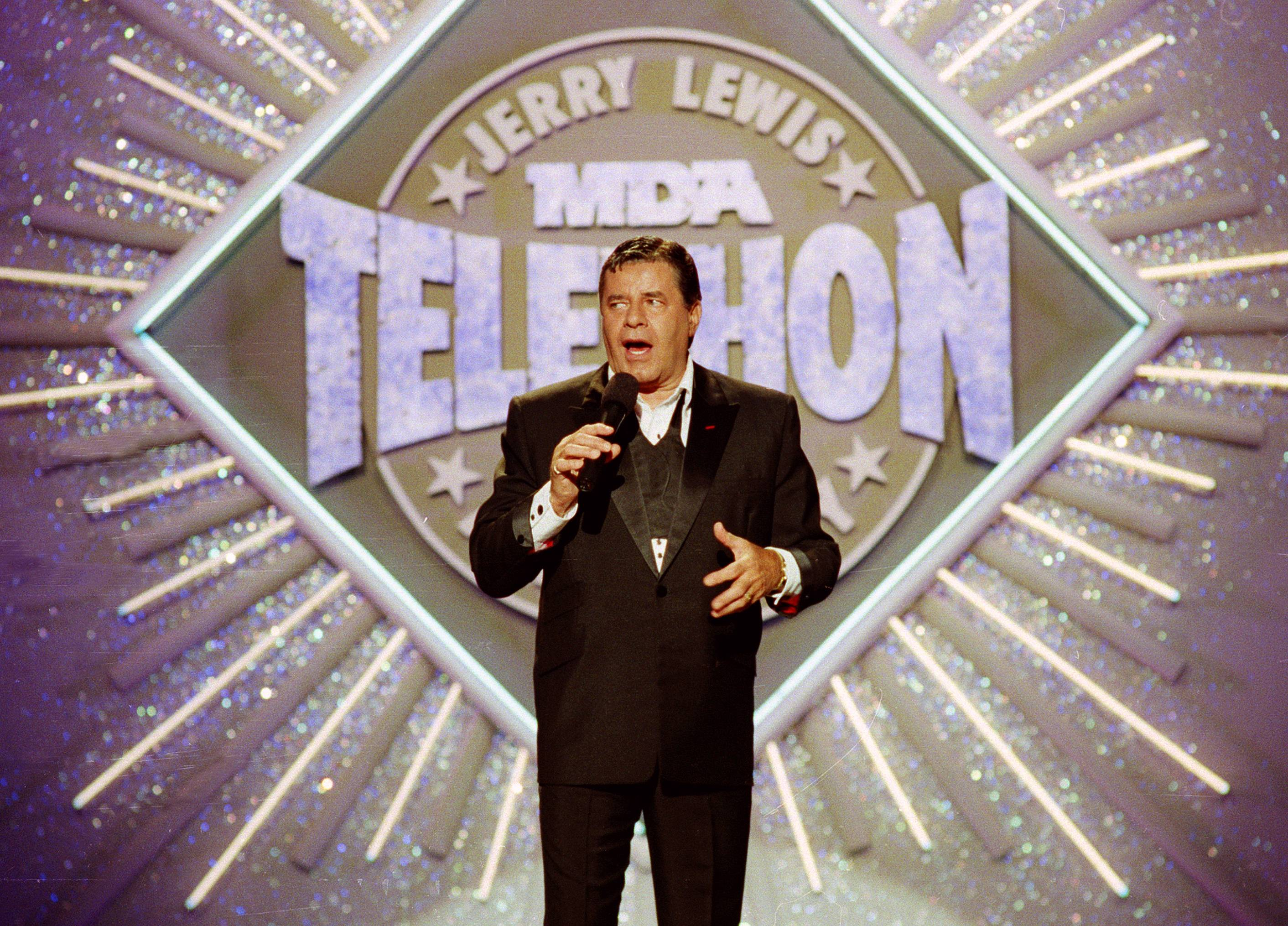 Entertainer Jerry Lewis makes his opening remarks in 1990 at the 25th Anniversary of the Jerry Lewis MDA Labor Day Telethon fundraiser in Los Angeles. Lewis, the comedian whose fundraising telethons became as famous as his hit movies, has died according to his publicist.