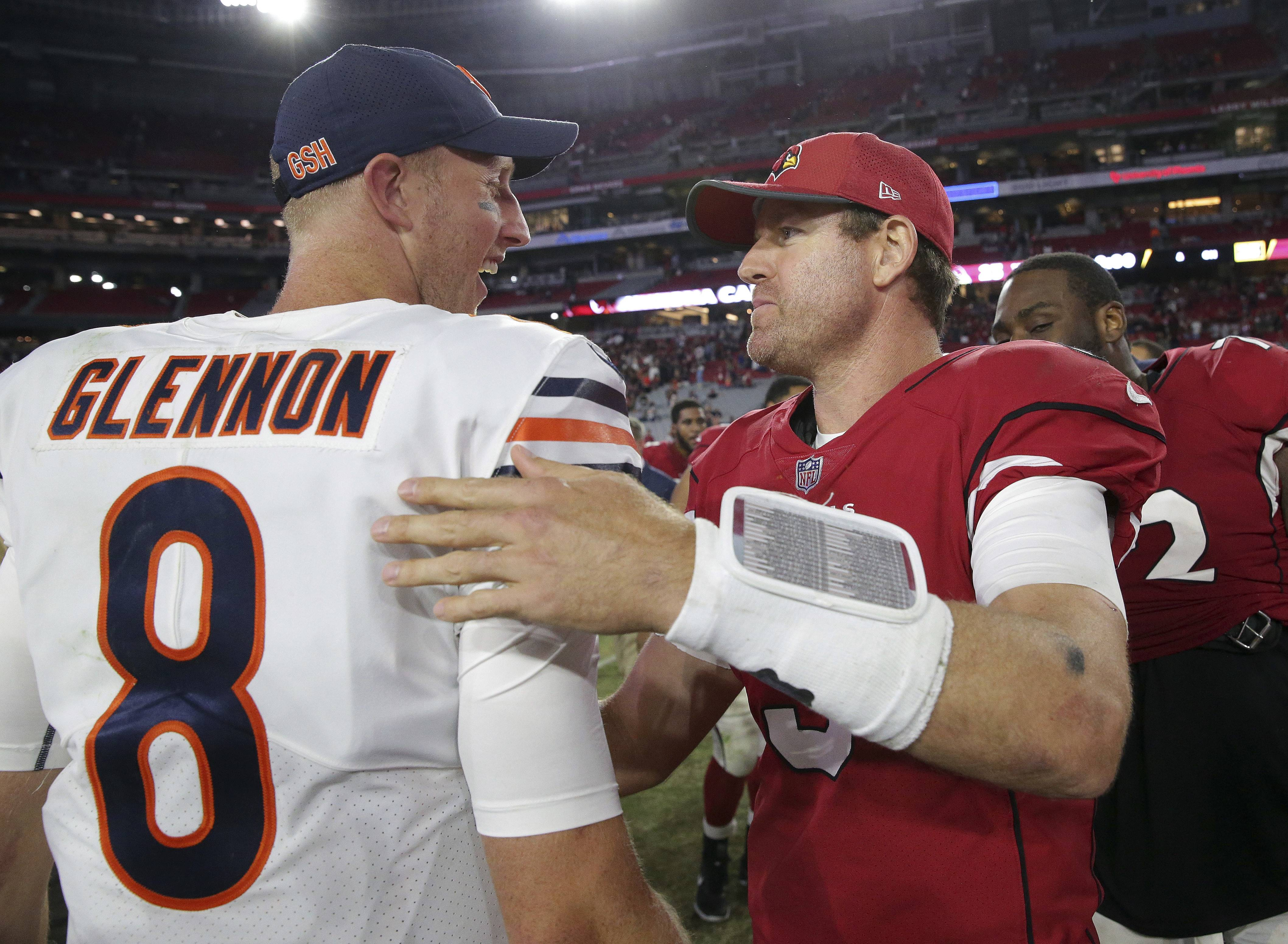 Chicago Bears quarterback Mike Glennon (8) greets Arizona Cardinals quarterback Carson Palmer (3) after an preseason NFL football game, Saturday, Aug. 19, 2017, in Glendale, Ariz. The Bears won 24-23. (AP Photo/Ralph Freso)