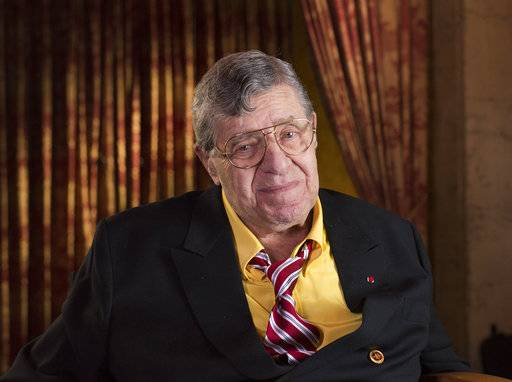 FILE - In this April 12, 2014, file photo, actor and comedian Jerry Lewis poses during an interview at TCL Chinese Theatre in Los Angeles. Lewis, the comedian and director whose fundraising telethons became as famous as his hit movies, has died. Lewis died Sunday, Aug. 20, 2017, according to his publicist. He was 91. (Photo by Dan Steinberg/Invision/AP Images, File)