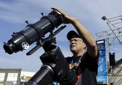 Ray Cooper, volunteer for the Oregon Museum of Science and Industry, preps his equipment to provide live video of the Aug. 21, 2017, solar eclipse at the state fairgrounds in Salem, Ore., Sunday, Aug. 20, 2017.(AP Photo/Don Ryan)