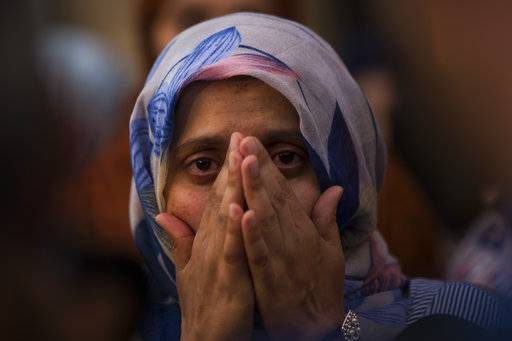 A woman weeps during a gathering of members of the local Muslim community along with relatives of young men believed responsible for the attacks in Barcelona and Cambrils to denounce terrorism and show their grief in Ripoll, north of Barcelona, Spain, Sunday Aug. 20, 2017. (AP Photo/Francisco Seco)