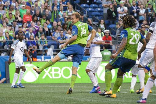 Seattle Sounders defender Chad Marshall scores on a header after a free kick by midfielder Nicolas Lodeiro in the first half against Minnesota United during an MLS soccer match Sunday, Aug. 20, 2017, in Seattle. (Bettina Hansen/The Seattle Times via AP)