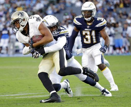 New Orleans Saints wide receiver Corey Fuller, left, is tackled by Los Angeles Chargers' Brad Watson during the second half of an NFL preseason football game Sunday, Aug. 20, 2017, in Carson, Calif. (AP Photo/Jae C. Hong)