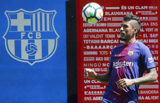 FC Barcelona's new signing Paulinho controls a ball during his official presentation at the Camp Nou stadium in Barcelona, Spain, Thursday, Aug. 17, 2017. Barcelona has reached a deal with Chinese club Guangzhou Evergrande to buy Brazil midfielder Paulinho for 40 million euros ($47 million). (AP Photo/Manu Fernandez)