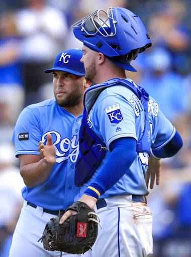 Kansas City Royals relief pitcher Kelvin Herrera, left, celebrates with catcher Cam Gallagher, right, following a baseball game against the Cleveland Indians at Kauffman Stadium in Kansas City, Mo., Sunday, Aug. 20, 2017. The Royals defeated the Indians 7-4. (AP Photo/Orlin Wagner)