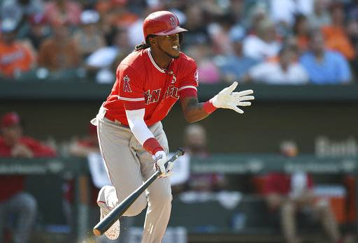 Los Angeles Angels' Cameron Maybin runs to first on a RBI single to give his team the 5-4 lead against the Baltimore Orioles' in the eighth inning of a baseball game, Sunday, Aug. 20, 2017, in Baltimore. (AP Photo/Gail Burton)