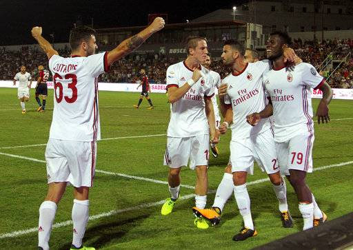 AC Milan's Frank Kessie, right, celebrates with teammates after scoring, during the Serie A soccer match between AC Milan and Crotone at the Ezio Scida stadium in Crotone, Italy, Sunday, Aug. 20, 2017. (Albano Angilletta/ANSA via AP)