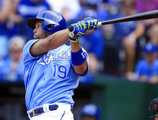 Kansas City Royals' Cheslor Cuthbert hits a two-run single during the fifth inning of a baseball game against the Cleveland Indians at Kauffman Stadium in Kansas City, Mo., Sunday, Aug. 20, 2017. (AP Photo/Orlin Wagner)