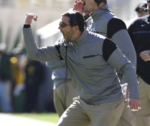 FILE - This Nov. 19, 2016 file photo shows Baylor offensive coordinator Kendal Briles reacting to a play against Kansas State in the first half of a NCAA college football game in Waco, Texas. Florida Atlantic is offering a second chance to Briles. The Owls' roster and coaching staff feature plenty of names of people who have encountered issues along the way to Boca Raton. Briles was the coordinator at Baylor under his father while the school was rocked by a sexual assault scandal. (Jerry Larson/Waco Tribune Herald via AP, file)