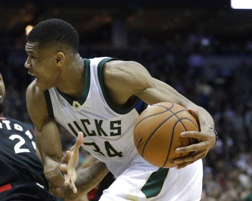 FILE - In this file photo dated Thursday, April 27, 2017, Milwaukee Bucks' Giannis Antetokounmpo runs with the ball during the second half of Game 6 of an NBA first-round playoff series basketball game in Milwaukee, USA.  Greece's basketball federation on Saturday Aug. 19, 2017, has accused the Milwaukee Bucks and the NBA of hatching a plan to prevent Giannis Antetokounmpo from playing in the European championship.
