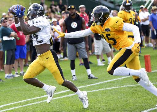 Pittsburgh Steelers wide receiver Antonio Brown (84) gets to a pass past cornerback Artie Burns (25) in a drill at practice during NFL football training camp in Latrobe, Pa., Wednesday, Aug. 16, 2017 . (AP Photo/Keith Srakocic)