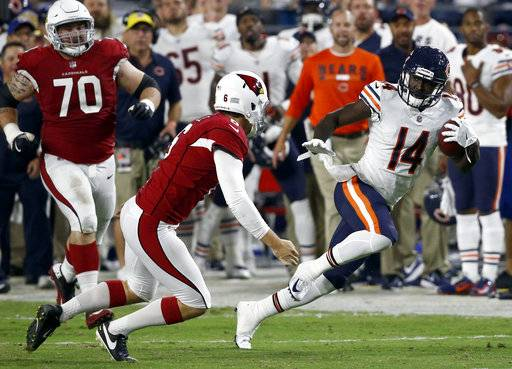 Chicago Bears wide receiver Deonte Thompson (14) runs back a missed field goal for a touchdown as Arizona Cardinals punter Matt Wile (6) defends during the first half of a preseason NFL football game, Saturday, Aug. 19, 2017, in Glendale, Ariz. (AP Photo/Ross D. Franklin)