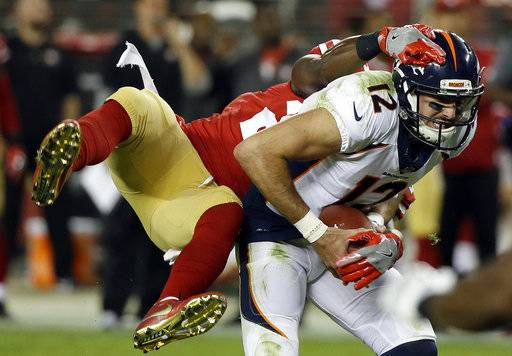 Denver Broncos quarterback Paxton Lynch (12) is sacked by San Francisco 49ers safety Jaquiski Tartt during the first half of a preseason NFL football game Saturday, Aug. 19, 2017, in Santa Clara, Calif.