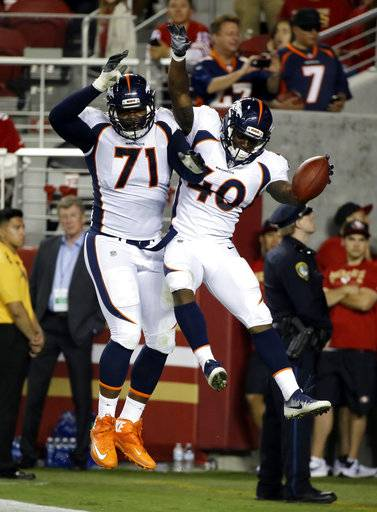 Denver Broncos running back Juwan Thompson (40) celebrates his rushing touchdown with Donald Stephenson (71) during the second half of a preseason NFL football game against the San Francisco 49ers on Saturday, Aug. 19, 2017, in Santa Clara, Calif.