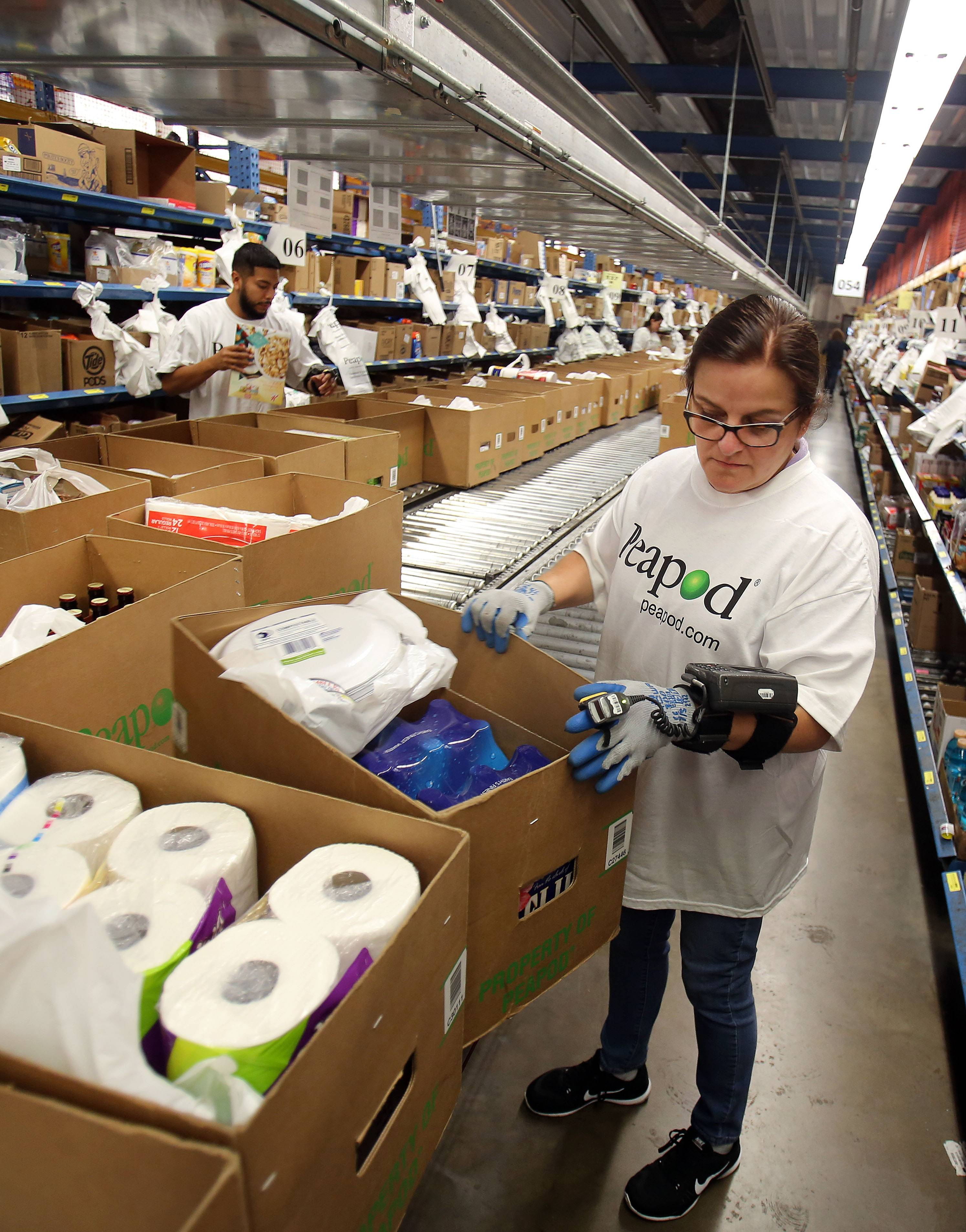 Maria Deanda packs orders at the Peapod facility in Lake Zurich.