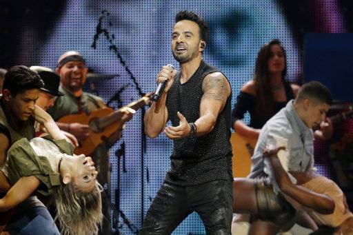 Luis Fonsi performs during the Latin Billboard Awards in Coral Gables, Fla. The Puerto Rican singer-songwriter feels blessed that his global success came at a point in his life where he's mature and grounded enough to simply enjoy it without losing touch with reality.