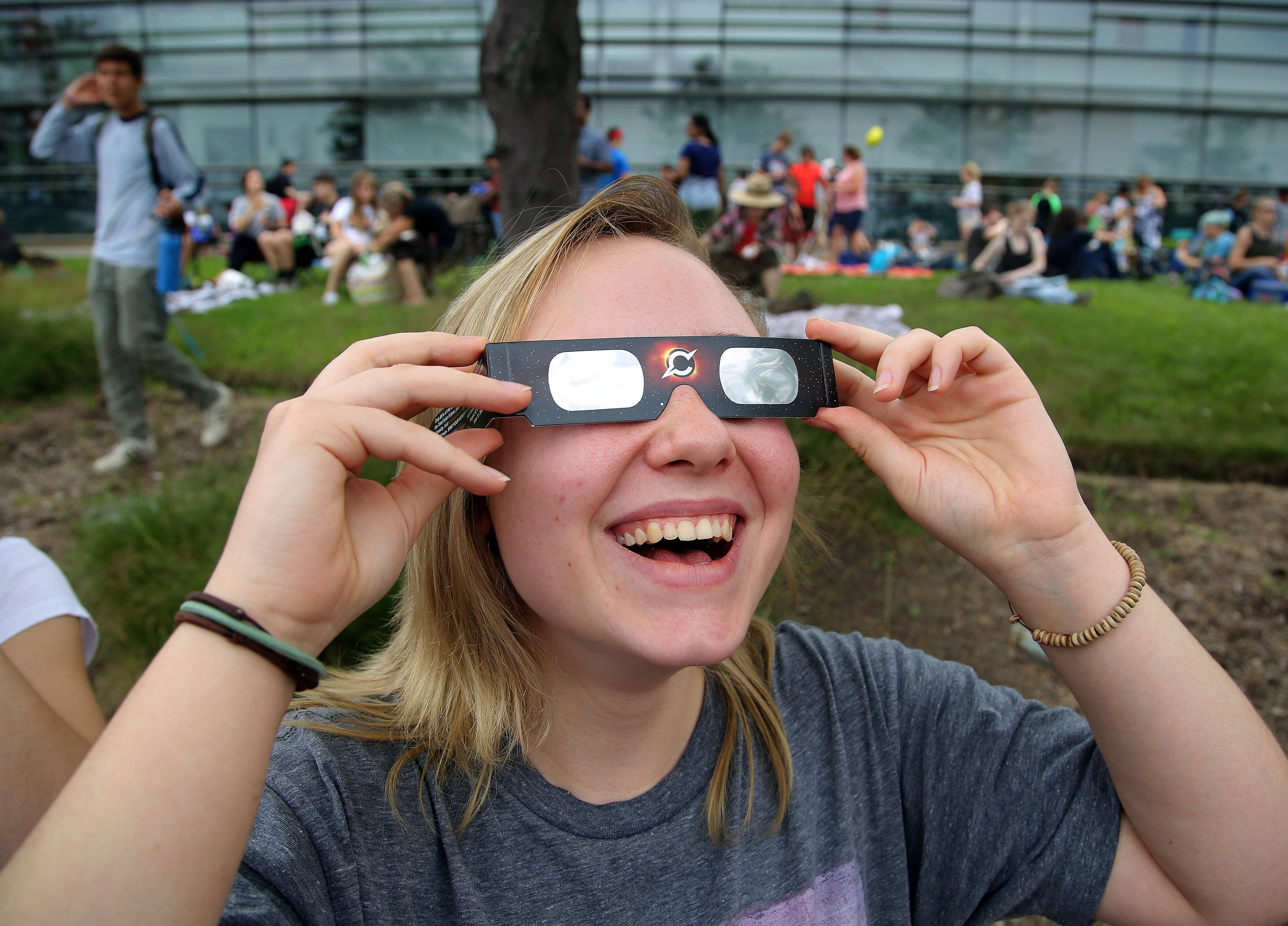 Student Anna Iwin of Schaumburg looks through special glasses during the eclipse.