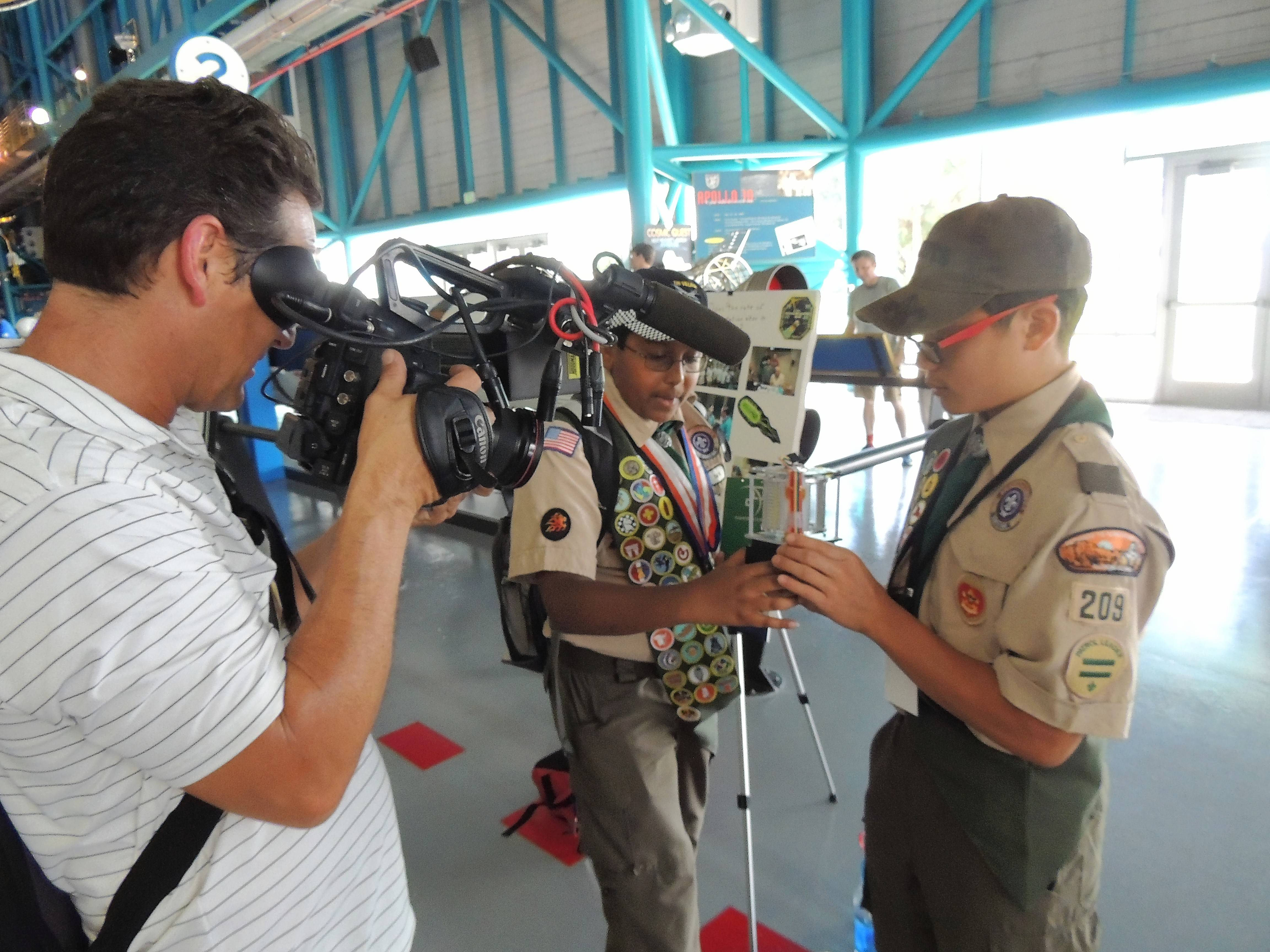 Scouts Saipranav Venkatakrishnan and Elliot Lee present their project to the local press.