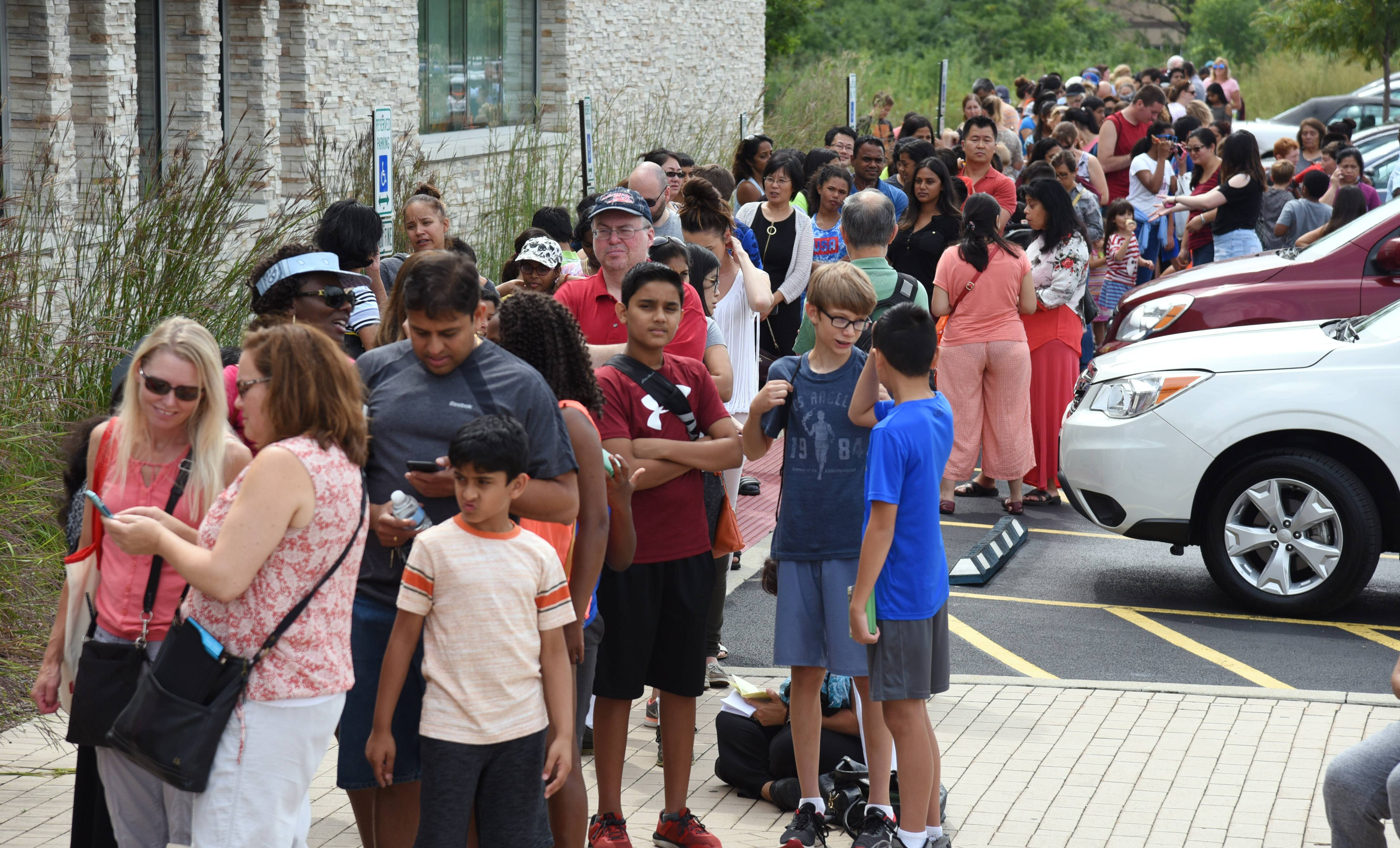 A line forms Monday morning at the Aspen Drive Library in Vernon Hills as patrons hope to get sunglasses to watch the eclipse.